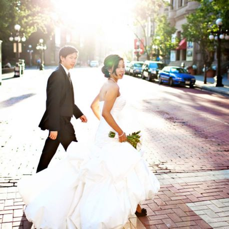 Bride and groom walking across 5th Street to the Landmark Center.